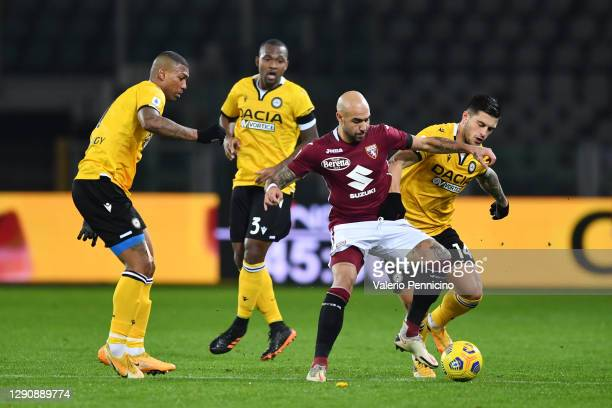 Simone Zaza of Torino F.C. And Kevin Bonifazi of Udinese Calcio battle for the ball during the Serie A match between Torino FC and Udinese Calcio at...