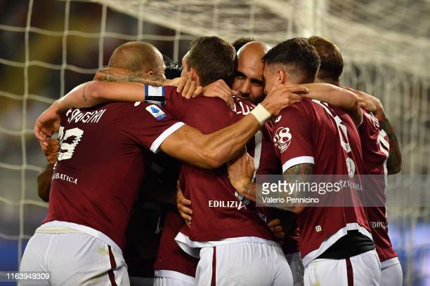 Simone Zaza of Torino FC celebrates the opening goal with team mates during the Serie A match between Torino FC and US Sassuolo at Stadio Olimpico di...