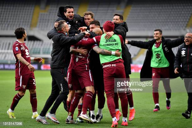 Simone Zaza of Torino F.C. Celebrates with teammates after scoring their team's second goal during the Serie A match between Torino FC and AS Roma at...