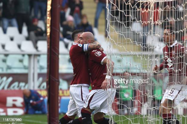 Simone Zaza of Torino FC celebrates with teammates after scoring during the Serie A football match between Torino FC and ACF Fiorentina at Olympic...