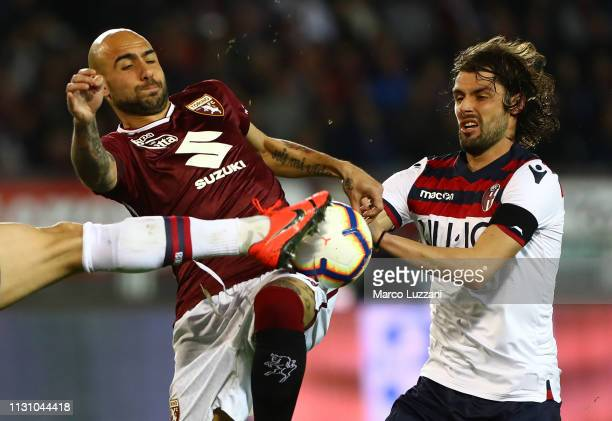 Simone Zaza of Torino FC competes for the ball with Andrea Poli of Bologna FC during the Serie A match between Torino FC and Bologna FC at Stadio...