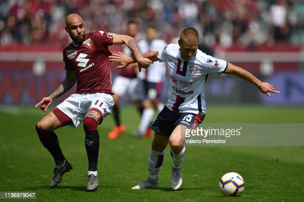 Simone Zaza of Torino FC competes with Ragnar Klavan of Cagliari during the Serie A match between Torino FC and Cagliari at Stadio Olimpico di Torino...