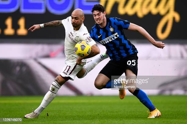 Simone Zaza of Torino FC is challenged by Alessandro Bastoni of FC Internazionale during the Serie A football match between FC Internazionale and...