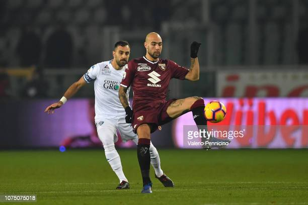 Simone Zaza of Torino FC is challenged by Domenico Maietta of Empoli during the Serie A match between Torino FC and Empoli at Stadio Olimpico di...