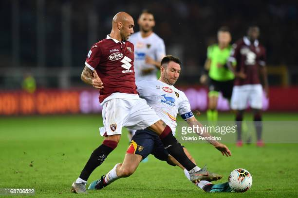 Simone Zaza of Torino FC is tackled by Fabio Lucioni of US Lecce during the Serie A match between Torino FC and US Lecce at Stadio Olimpico di Torino...