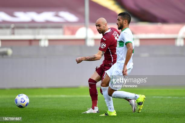 Simone Zaza of Torino F.C. Scores his sides first goal while under pressure from Jeremy Toljan of Sassuolo during the Serie A match between Torino FC...