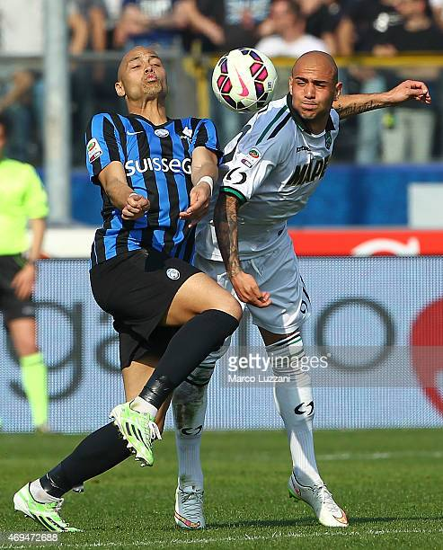Simone Zaza of US Sassuolo Calcio competes for the ball with Yohan Benalouane of Atalanta BC during the Serie A match between Atalanta BC and US...