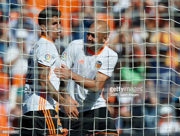 Simone Zaza of Valencia celebrates with Joao Cancelo of Valencia after scoring the third goal during the La Liga match between Valencia CF and CA...