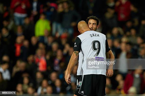 Simone Zaza of Valencia CF celebrates after scoring with his teammate Dani Parejo during the La Liga game between Valencia CF and Real Club Celta de...