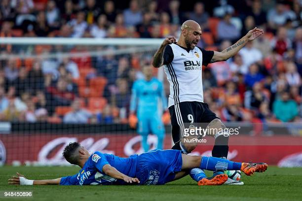 Simone Zaza of Valencia CF competes for the ball with Faycal Fajr of Getafe CF during the La Liga game between Valencia CF and Getafe CF at Mestalla...