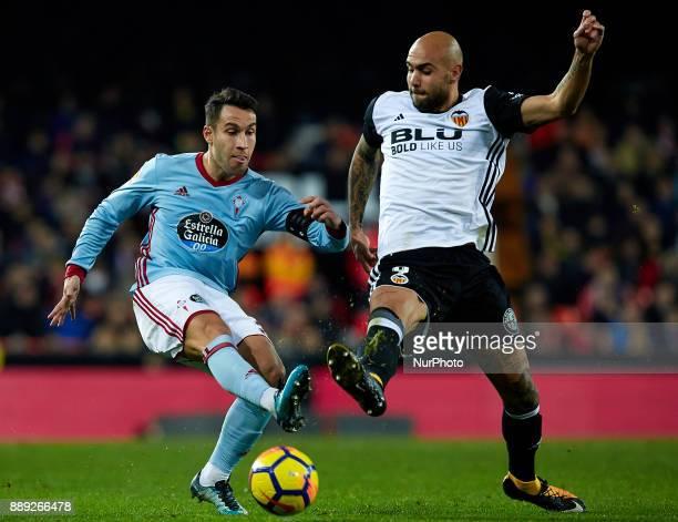 Simone Zaza of Valencia CF competes for the ball with Hugo Mallo of Real Club Celta de Vigo during the La Liga game between Valencia CF and Real Club...