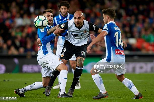 Simone Zaza of Valencia CF competes for the ball with Melendo and David Lopez of RCD Espanyol during the La Liga game between Valencia CF and RCD...