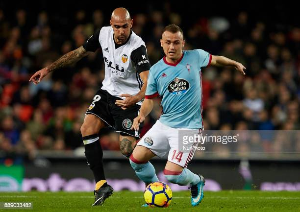 Simone Zaza of Valencia CF competes for the ball with Stanislav Lobotka of Real Club Celta de Vigo during the La Liga game between Valencia CF and...