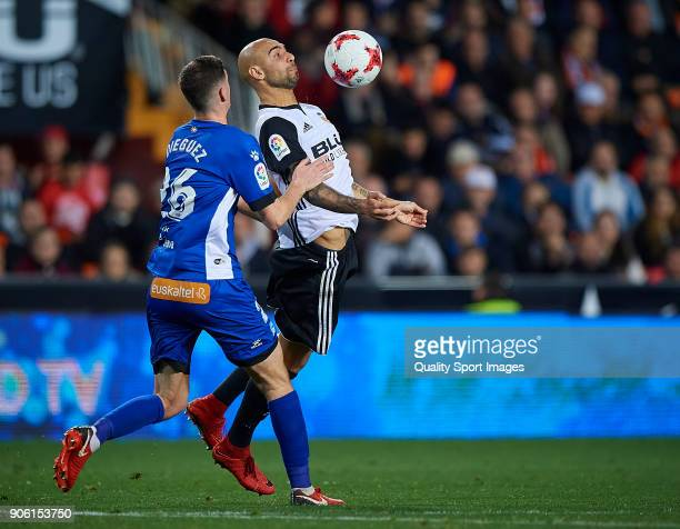Simone Zaza of Valencia competes for the ball with Adrian Dieguez of Alaves during the Copa Del Rey 1st leg match between Valencia and Alaves at...
