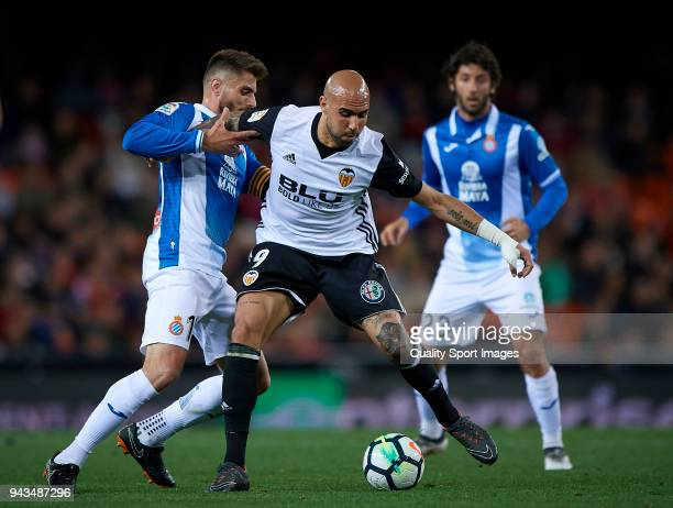Simone Zaza of Valencia competes for the ball with David Lopez of Espanyol during the La Liga match between Valencia and Espanyol at Mestalla Stadium...