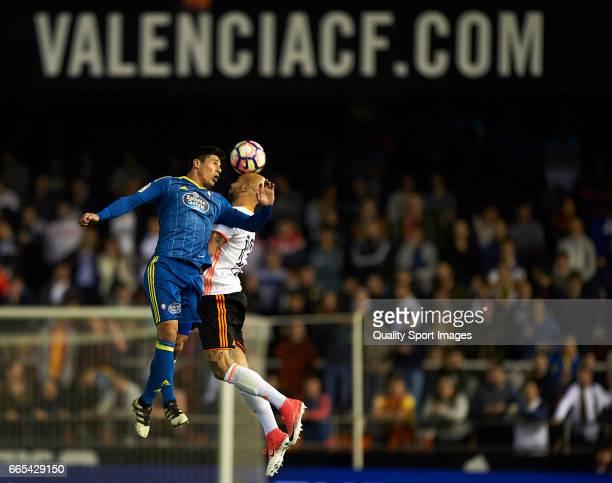 Simone Zaza of Valencia competes for the ball with Fecundo Roncaglia of Celta de Vigo during the La Liga match between Valencia CF and RC Celta de...