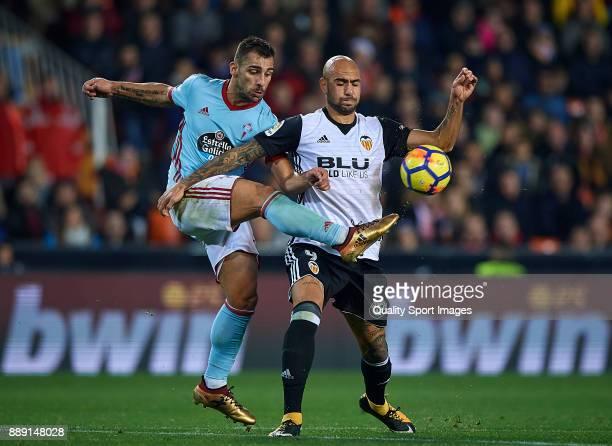 Simone Zaza of Valencia competes for the ball with Hugo Mallo of Celta de Vigo during the La Liga match between Valencia and Celta de Vigo at...