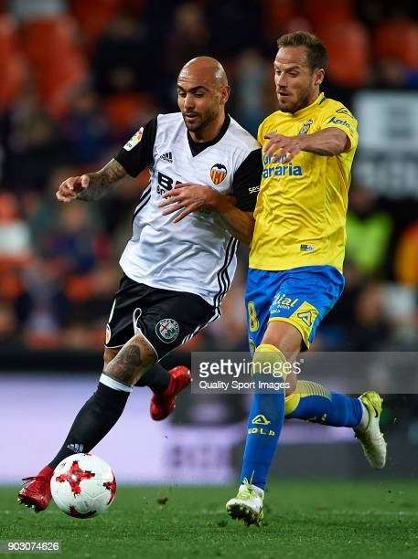 Simone Zaza of Valencia competes for the ball with Javi Castellano of Las Palmas during the Copa del Rey Round of 16 second Leg match between...