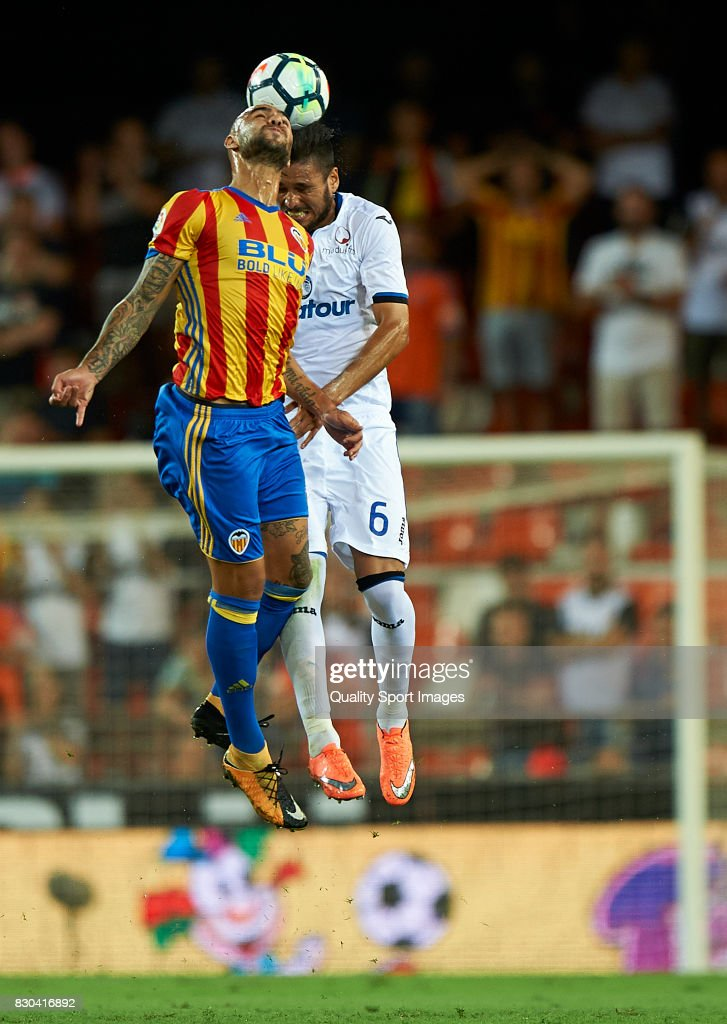 Simone Zaza (L) of Valencia competes for the ball with Luis Palomino of Atalanta during the pre-season friendly match between Valencia CF and Atalanta BC at Estadio Mestalla on August 11, 2017 in Valencia, Spain.