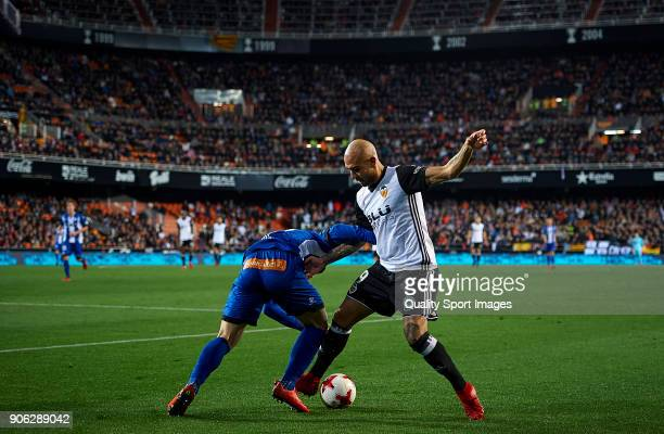 Simone Zaza of Valencia competes for the ball with Raul Garcia of Alaves during the Copa Del Rey 1st leg match between Valencia and Alaves at Estadio...