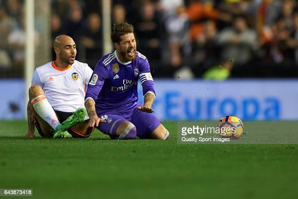 Simone Zaza of Valencia competes for the ball with Sergio Ramos of Real Madrid during the La Liga match between Valencia CF and Real Madrid at...