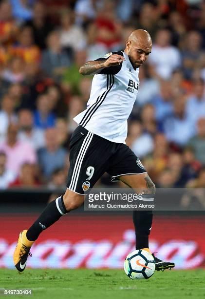 Simone Zaza of Valencia runs with the ball during the La Liga match between Valencia and Malaga at Estadio Mestalla on September 19 2017 in Valencia...