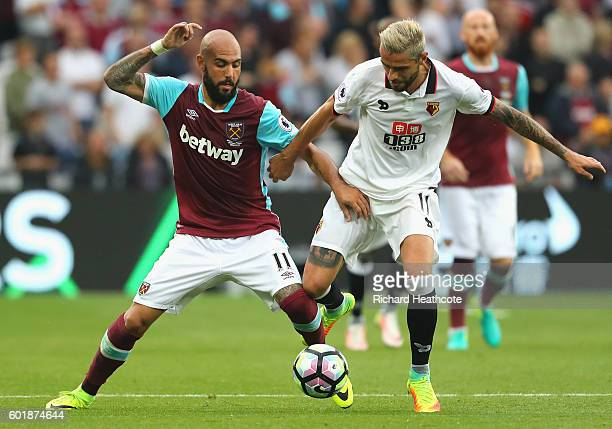 Simone Zaza of West Ham United and Valon Behrami of Watford battle for possession during the Premier League match between West Ham United and Watford...