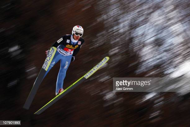 Simoni Ammann of Switzerland competes during trial round for the FIS Ski Jumping World Cup event of the 59th Four Hills ski jumping tournament at...