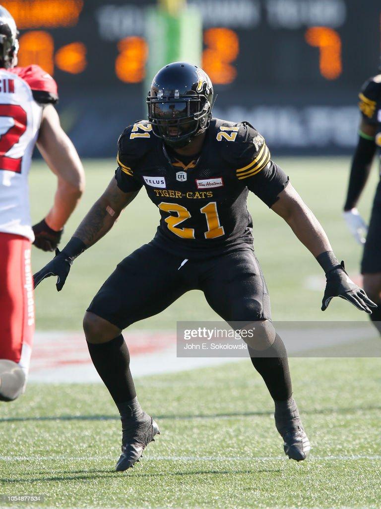 Simoni Lawrence of the Hamilton Tiger-Cats defends against the ... 72e76c2ad