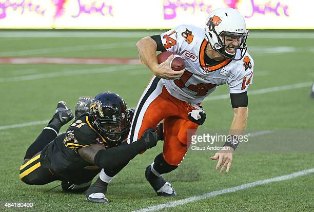 Simoni Lawrence of the Hamilton TigerCats sacks Travis Lulay of the BC Lions during a CFL football game at Tim Hortons Field on August 15 2015 in...