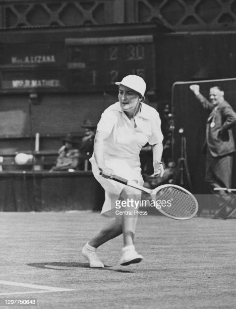 Simonne Mathieu of France makes a backhand return to Anita Lizana of Chile during their Women's Singles Second Round match at the Wimbledon Lawn...