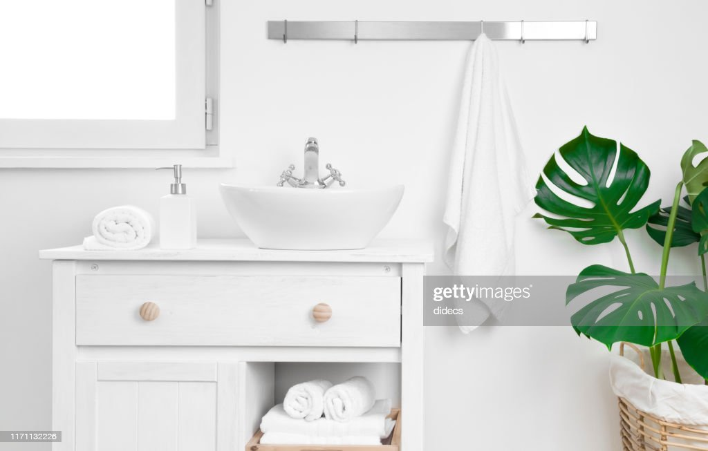 Simple bathroom cabinet with various supplies. Storage and organizing concept : Stock Photo