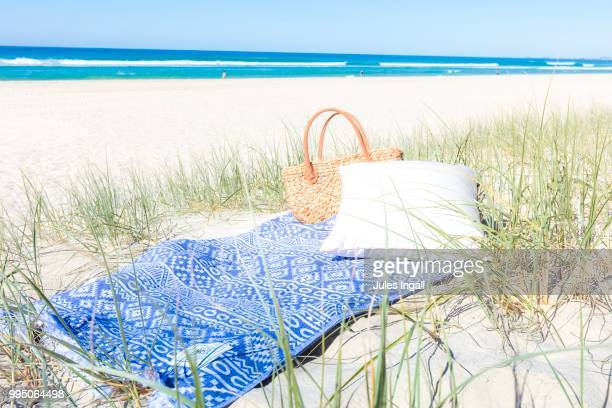 simple beach picnics - picnic blanket stock pictures, royalty-free photos & images