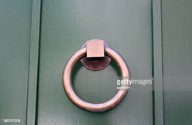 simple brass door knocker - door knocker stock photos and pictures
