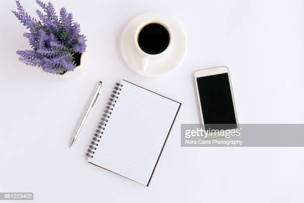 simple business table with mock up office supplies and smartphoneon white - elektronische organiser stockfoto's en -beelden