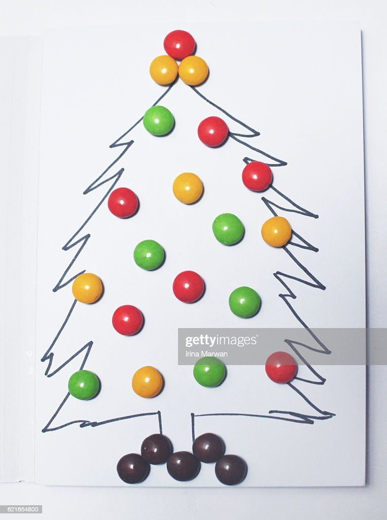 simple christmas tree illustration with candy decorations ストック