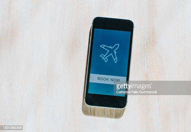 simple image of a mobile phone displaying an air travel booking app - passenger craft stock pictures, royalty-free photos & images