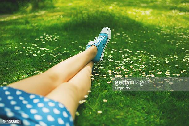 simple joys - legs crossed at ankle stock pictures, royalty-free photos & images