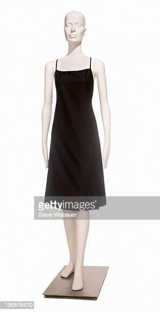 A simple little black dress on a mannequin