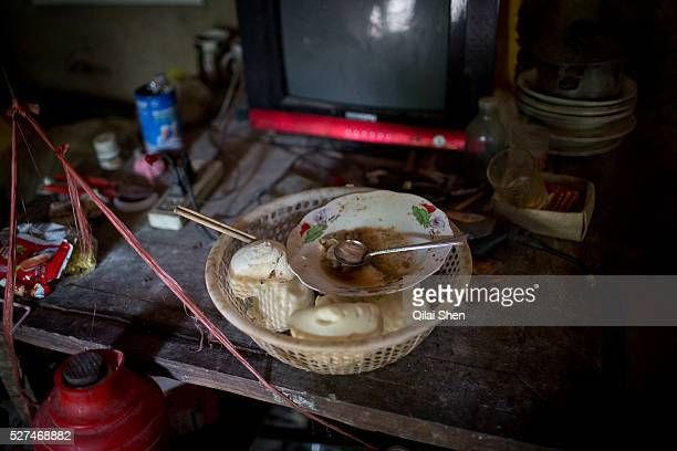 Simple lunch left on the table of 71 year old Hou Guiying and her husband 81 year old Ma Jinling at a rural village near Fuyang Anhui Province China...
