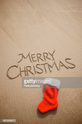 Simple merry christmas holiday greeting message smooth brown sand simple merry christmas holiday greeting message smooth brown sand stock photo getty images m4hsunfo