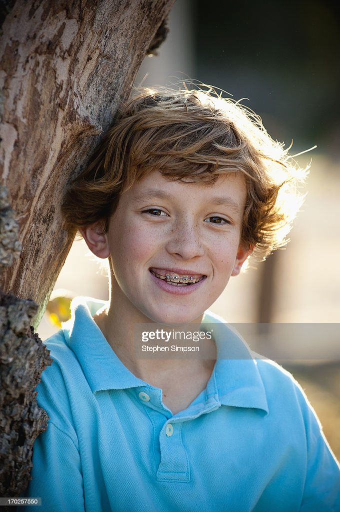 simple outdoor portrait, pre-teen boy with braces : Stock Photo