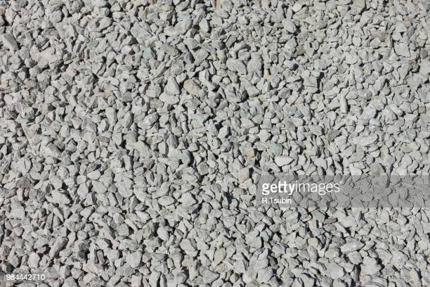 simple small grayish stones used in road construction - rubble stock photos and pictures
