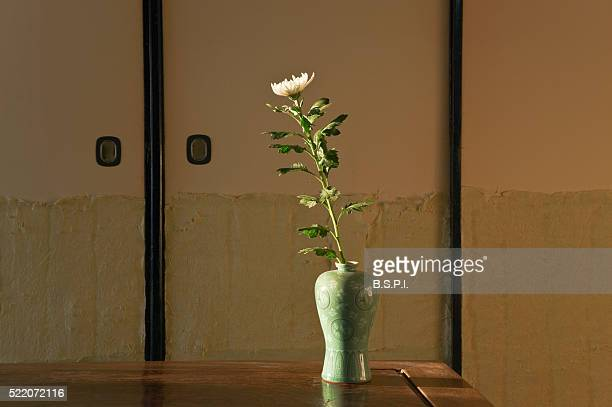 Simple Vase with a Single Chrysanthemum in a Traditional Machiya Townhouse Residence in Kyoto, Japan