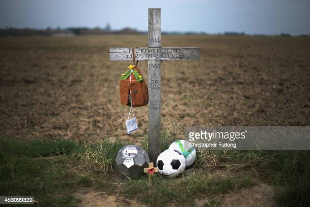 A simple wooden memorial cross marks the field outside Ploegsteert Wood Flanders where British and German soldiers played football during the World...