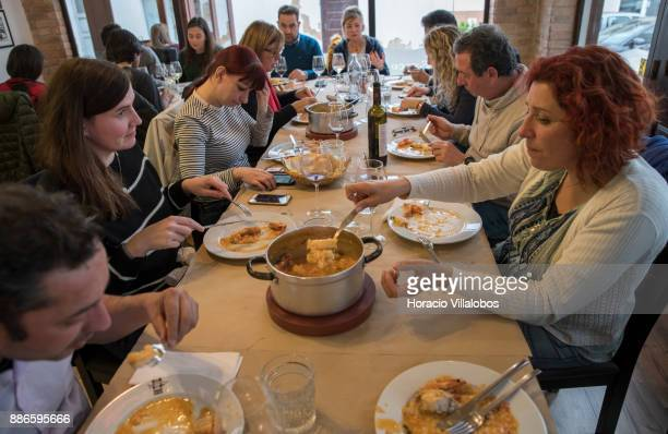 Simply b general manager Sandra Tavares serves seafood rice at lunch in Taberna Du2019Adelia restaurant during Gastronomic FAM Tour on November 27...