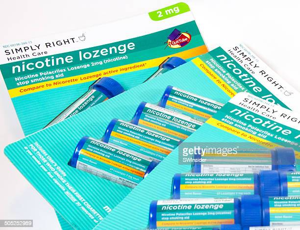simply right nicotine lozenges - sublingual stock pictures, royalty-free photos & images