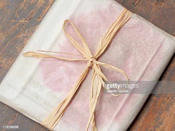 Simply wrapped gift on wood table