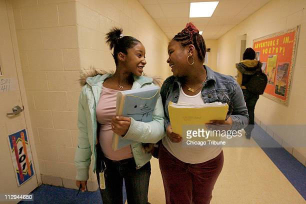 Simpson Academy students Kenesha Perry left and Allegra Kennedy chat as they change classrooms on Wednesday October 17 2007 in Chicago Illinois