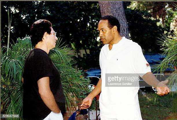 Simpson, after his acquittal, at his home in Brentwood with Robert Kardashian.